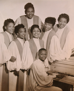 "HARDY19.... Evelyn Hardy, pianist for the Original Gospel Harmonettes, is shown at 6th Street Baptist Church where she is active in the music programs. She is set to receive yet another honor for her years in music. This is a copy of an original publicity photo for the Original Gospel Harmonettes. ID's as follows: Dorothy Love Coates (top rear) l to r: Mildred Howard, Vera Kolb, Willie Mae Newberry, Evelyn Hardy and Odessa Edwards. Seated at piano: Herbert ""PeeWee"" Pickard. STAFF PHOTO JEFF ROBERTS: REPORTER GARRISON...."